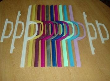 Kupić Rączki do toreb foliowych z tworzywa PEHD z zamknięciem zatrzaskowym, rózne kształty wielkosci i kolory.