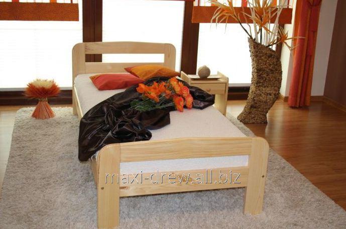 Łóżko Klara o prostej, ponadczasowej formie, dodatkowo wzmacniane.