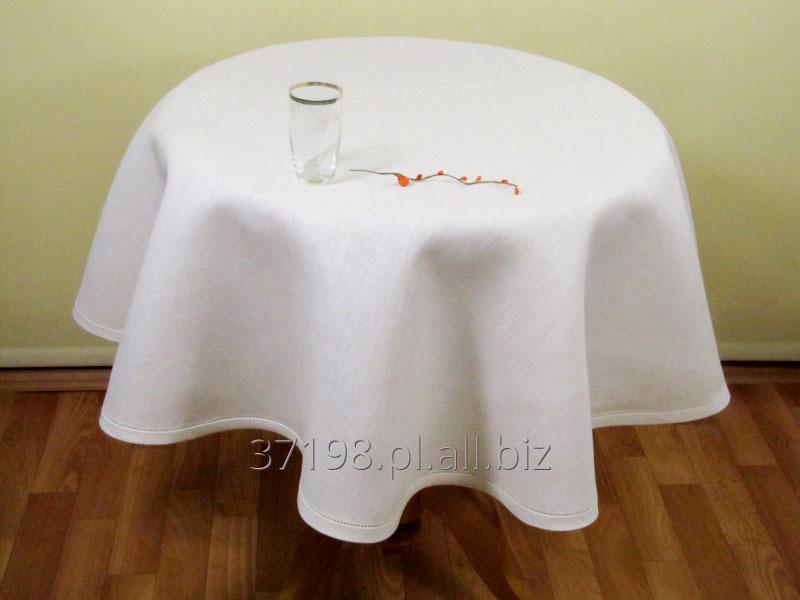 Kupić Obrus okrągły w kolorze kremowym, wykończony 2 cm lamówką, ozdobiony mereżką wzdłuż lamówki.