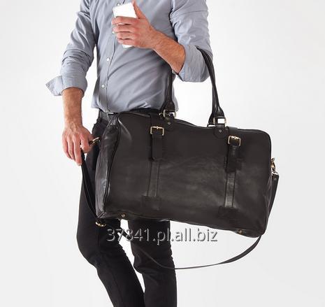 Kupić Stylowa męska torba podróżna skórzana z paskiem na ramie.