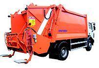 Śmieciarki z tylnym załadunkiem.  Rear loading garbage trucks.