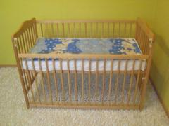 Cot (crib) made of beech wood with dropside.