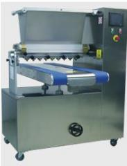 Machines for rolling out of paste