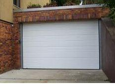 Automation for sectional doors