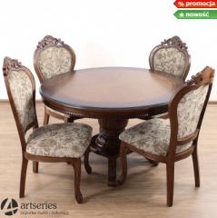 Duży okrągły stół drewniany ze stylowymi krzesłami