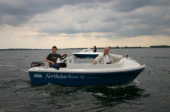 Fast motor boat with an open deck for a variety of