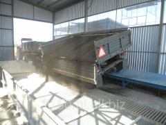 Units for unloading grain from the bags