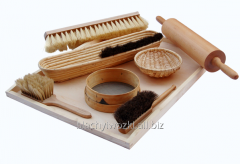 Professional pastry brushes in a wooden frame.