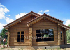Construction of houses from wooden logs by