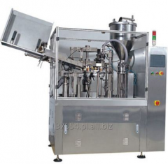 Tubiarka automatyczna do napełniania i zgrzewania tub plastikowych.