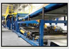 Projektowanie i wykonanie kompleksowe linii do produkcji płyt warstwowych tzw. paneli typu sandwich.