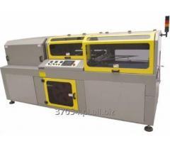 Automat kątowy do pakowania w folię termokurczliwą