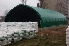Specjalistyczna hala łukowa dla rolnictwa z możliwością zamknięcia bramą rolowaną lub wrotami. Plandeka w dowolnej kolorystyce RAL