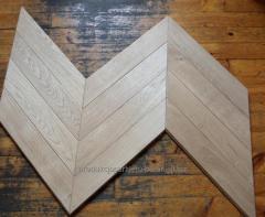 Deska na podłogę w jodełkę francuską z drewna dębowego (dąb europejski) z fazą czterostronną ścinaną pod kątem 45 stopni, stan deski surowy.