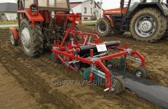 Pasywna maszyna do formowania i okrywania kopców przy uprawie truskawek, ogórków, malin, marchewki.