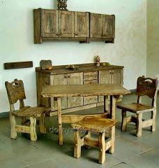 A set of wooden kitchen furniture decorated with