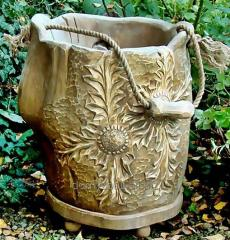 Pot with a wooden carving is a perfect ornament