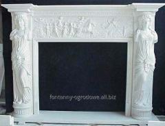 Elegant fireplace made of white marble,