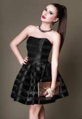 A short black dress with a bodice and a flared
