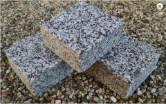 Stone blocks sawn and chipped from granite of gray