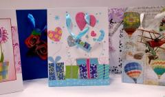 Paper packages for gifts (shining, laminated with
