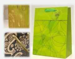 Gift packages of an opaque laminate, packages of a