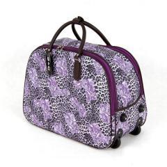 Sakwojaż - fioletowa duża torba podróżna na kółkach w cętki