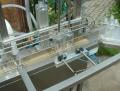 Dozownik płynów - podajnik taśmociągowy