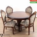 Duży okrągły stół drewniany ze stylowymi krzesłami tapicerowanymi