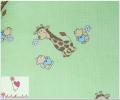 Pieluszki żyrafki na zielonym tle