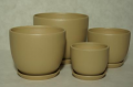 Ceramic pots in a classic, subtle shape, with ceramic plate in a set.