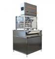 Dekoratorka automatyczna DC do ozdabiania czekoladą ciastek, pierników, galaretek itp. z własną taśmą.