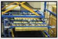 Linie do obróbki wełny mineralnej- cięcie, frezowanie itp.- na lamele z rowkami klinowymi, do produkcji płyt warstwowych.