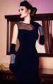 Paola, długa elegancka suknia rozchodząca się ku dołowi w kształcie dzwonka. Ponadczasowo gustowna, wygodna dzięki użyciu wysokiej jakości miękkiej tkaniny.