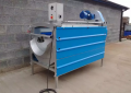 Vegetable brush washer with adjustable speed and height hopper