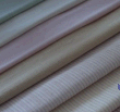 Tkaniny ubraniowe przeznaczone do produkcji męskiej odzieży eleganckiej wyprodukowane z wełny z domieszką poliestru lub ze 100% wełny.