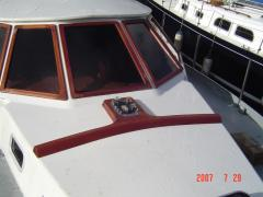 Naprawy kadłubów jachtów (laminat, drewno, stal)