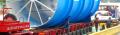 Przeładunek i przewóz ładunków nietypowych, ciężkich i ponadgabarytowych takich jak maszyny budowlane, konstrukcje stalowe i żelbetonowe elementy linii technologicznych, wieże wiatrowe, transformatory, jachty, suwnice i maszyny rolnicze